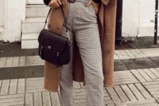 02 a black long sleeve top, printed pants, a camel coat and grey trainers plus a black bag