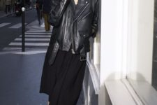 02 a black midi dress, white sneakers and an oversized black leather jacket for an effortlessly chic look