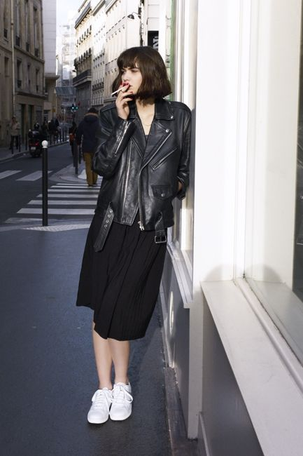 a black midi dress, white sneakers and an oversized black leather jacket for an effortlessly chic look