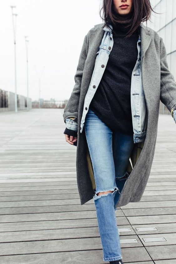 a black turtleneck, a denim jacket, ripped jeans, a grey coat for a comfortable fall to winter look