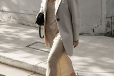 02 a creamy slip midi dress, an oversized creamy blazer, white trainers and a small black bag