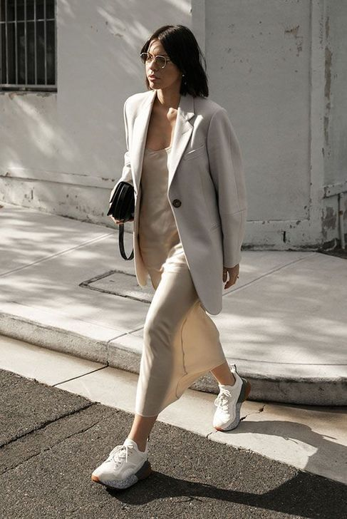 Picture Of a creamy slip midi dress, an oversized creamy blazer ...