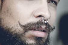 02 a nose septum piercing with a hoop plus a super edgy beard and moustache for an edgy touch