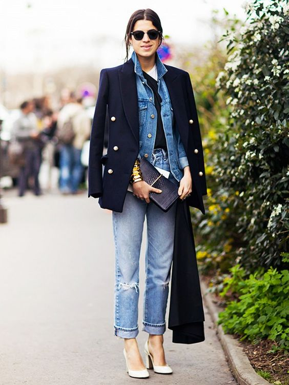 a black tee, blue jeans, a blue denim jacket, a short black coat over for a bold look