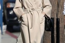 03 a creamy midi robe coat with large pockets and a classic collar worn by Angelina Jolie is a gorgeous idea