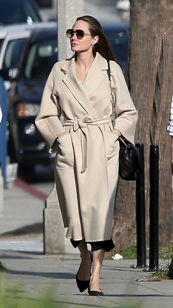 a creamy midi robe coat with large pockets and a classic collar worn by Angelina Jolie is a gorgeous idea