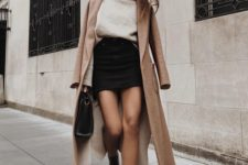 03 a creamy turtleneck sweater, a black denim mini, black booties, a camel coat and a black bag