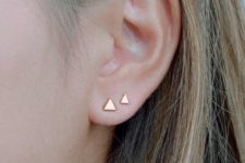 03 a duo of minimalist gold triangle studs will give a chic minimal feel to your look