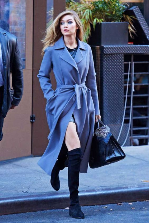 a blue midi robe coat with pockets worn by Gigi Hadid is a super cool idea and a color statement