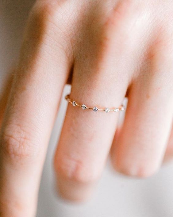 a minimalist gold ring dotted with diamonds is a very beautiful and shiny jewelry idea