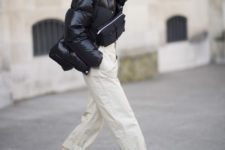 05 a cool look with neutral pants, a puffy black jacket, a black bag and black and white trainers