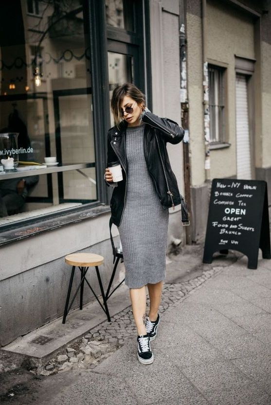 a grey sweater dress, black sneakers and an oversized black leather jacket for a casual look
