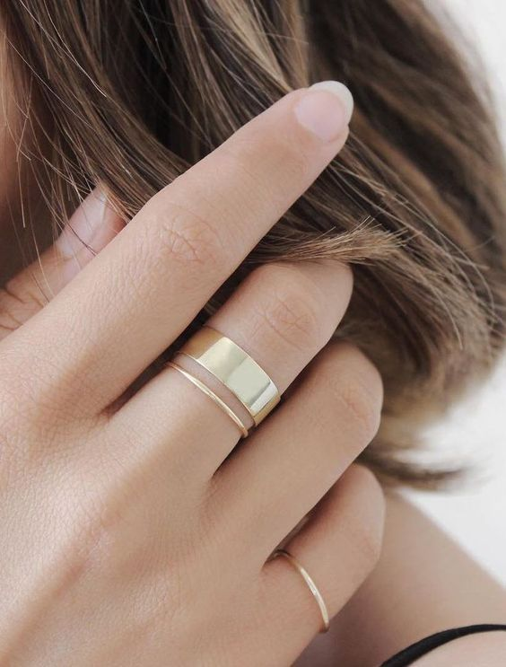 minimalist gold rings   thin ones and a wide one for creating a bold modern combo