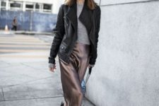 06 a grey sweater, a taupe silk midi skirt, black boots and an oversized leather jacket