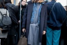 06 a grey sweater dress with tied up sleeves, black booties, a denim jacket and a midnight blue coat over it