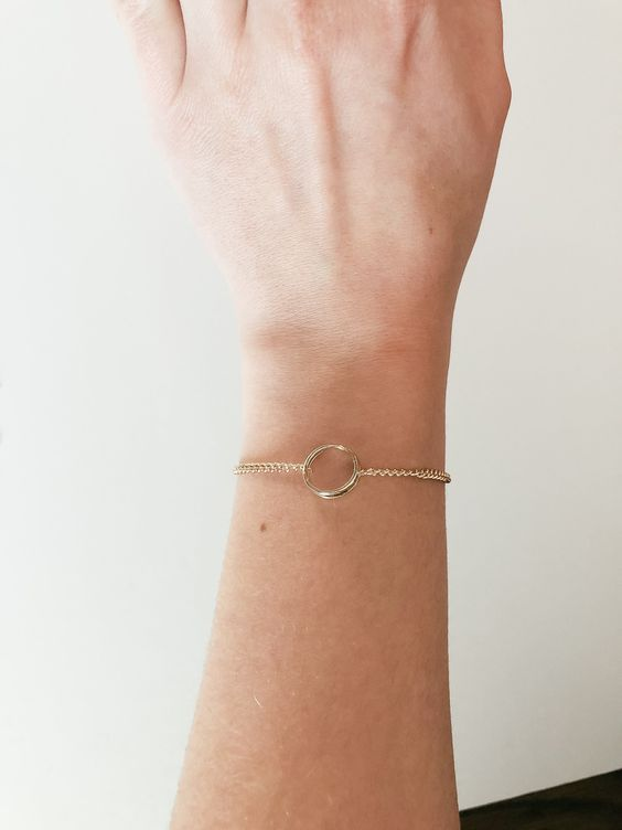 a minimalist circle bracelet with a thick chain will make a statement though it's very simple