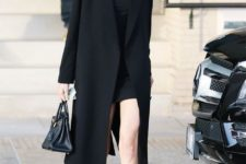 07 a black straight coat, a black turtleneck dress, white snakers worn by Kendall Jenner for a minimalist chic outfit