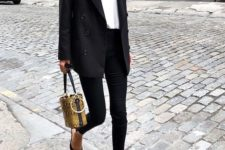 07 a chic look with a black oversized blazer, black skinnies, a white turtleneck, black mules and a bucket bag