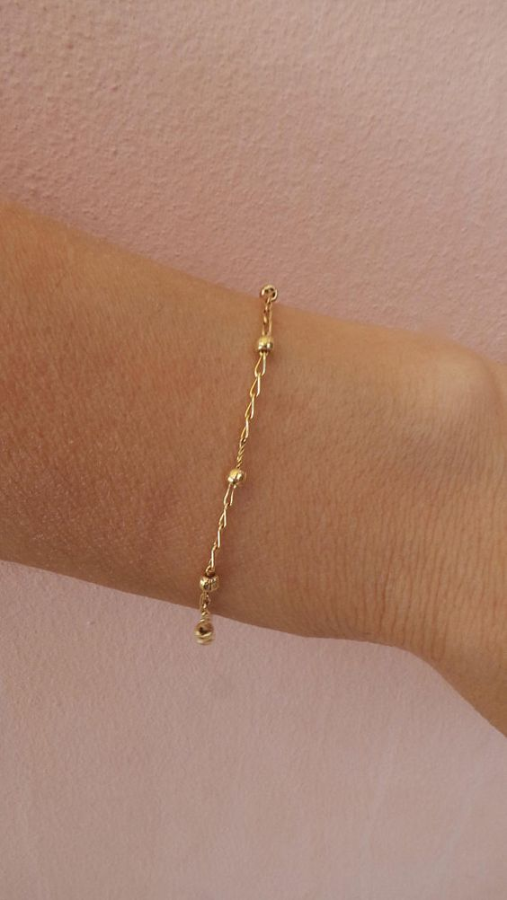 a minimalist gold chain bracelet with tiny beads is a timeless idea that will always be in trend