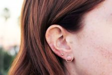07 minimalist gold studs and a duo of gold hoops are all you need to accessorize your ear