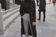 08 a classic and minimalist outfit with a black turtleneck, printed pants, blakc loafers, a black coat and a beret