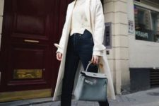 08 a neutral sweater, black jeans, a white trench, white and black trainers and a powder blue bag