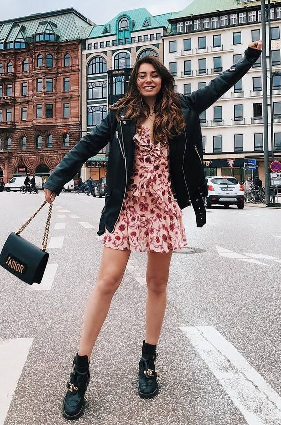 a pink floral mini dress, black boots, a black leather jacket and a bag for a girlish meets edgy look