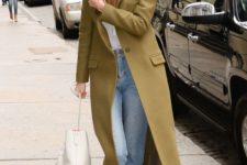 08 an olive green maxi straight coat worn by Gigi Hadid, a white shirt and blue jeans for a casual everyday look