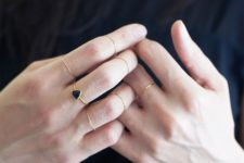 08 minimalist gold rings and a single black triangle one for a contrasting touch