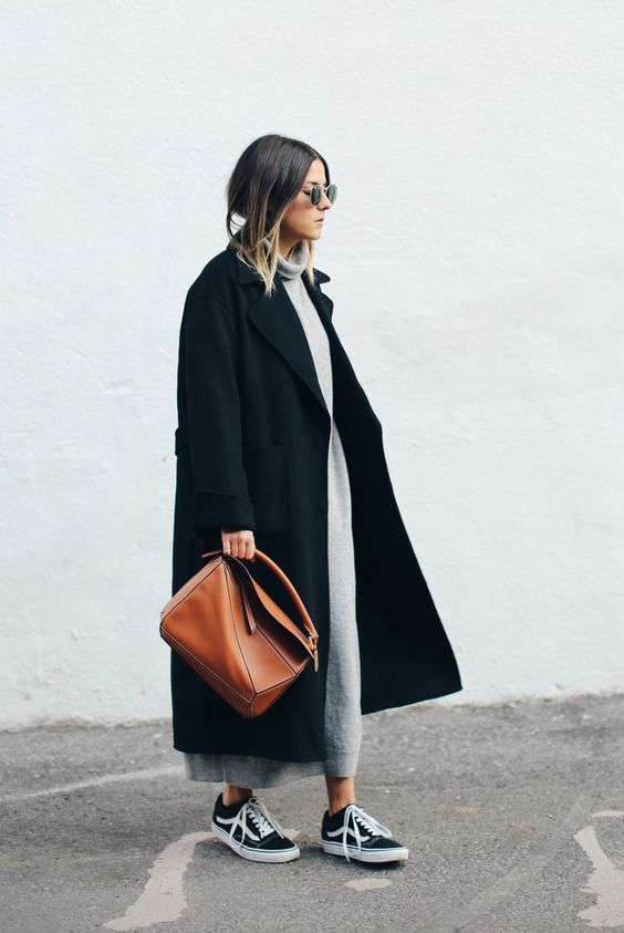 a chic minimalist look with a straight blakc oversized coat and a grey sweater dress plus black sneakers