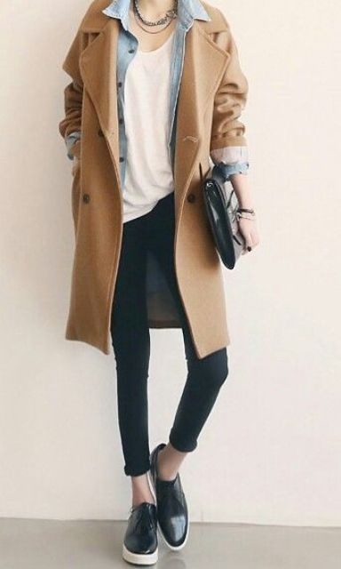 a minimalist look with black skinnies, a white tee, a blue denim jacket, a camel coat, black boots and a bag