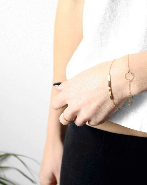 two chain bracelets - with a circle and with a bar plus some minimalist rings to make the look edgy
