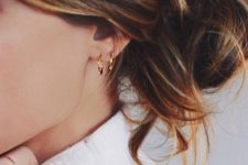 10 a duo of gold hoops and matching rings will make your look very trendy