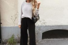 10 a neutral sweater, black cropped pants, white sneakers and a black bag for a cozy fall outfit