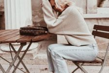 10 a simple and comfy fall outfit with bleached cropped jeans and a neutral sweater, white sneakers and a brown clutch