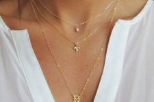 10 a trio of minimalist necklaces with a triangle, a leaf and a single pearl is a minimal and boho idea