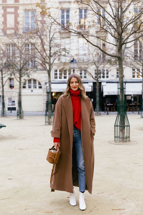 an oversized brown straight coat calms down a bright outfit with a red sweater and makes the look bolder