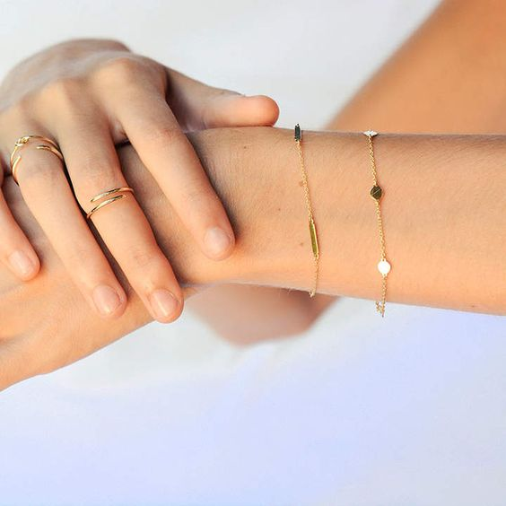 two minimalist chain bracelets with gold bars and little coins will make your look chic and delicate