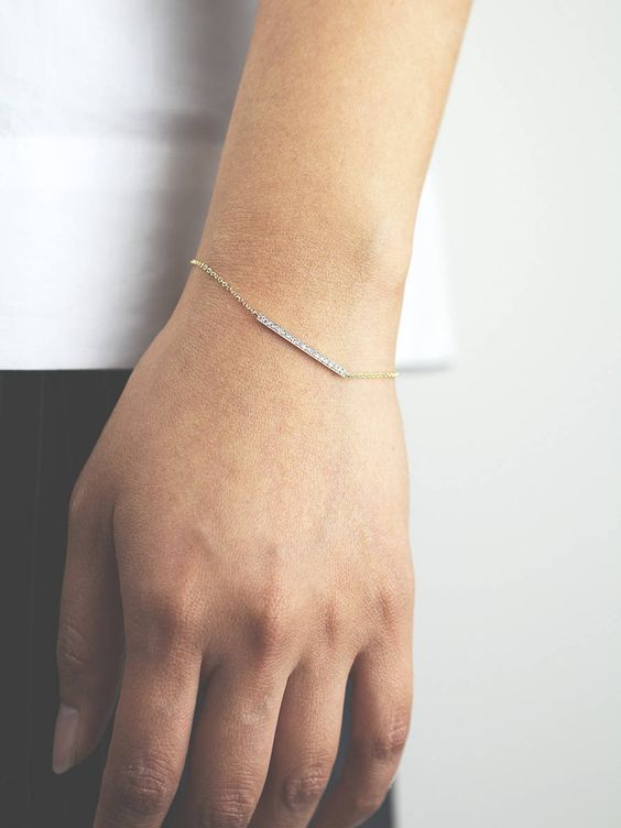 a minimalist bracelet with a diamond set thin bar is a very elegant idea to go for
