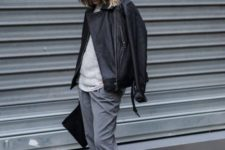 11 a minimalist look with grey pants, a grey top, white sneakers and a black leather jacket plus a clutch