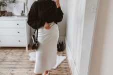 12 a black hoodie, a white midi skirt, neutral trainers and a small black bag for a monochromatic look