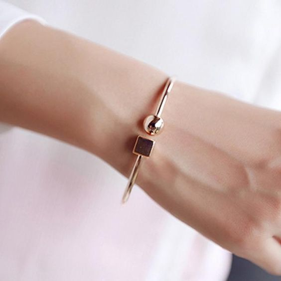 a gorgeous geometric bracelet with a cube and a bead is a stylish and bold idea with a minimal feel