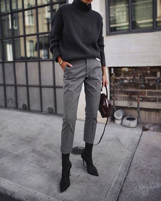 a stylish look with a grey oversized sweater, cropped pants, black sock boots and a burgundy bag