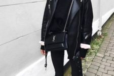 12 an oversized black leather jacket, a black turtleneck, black cropped skinnies, black mules and a crossbody