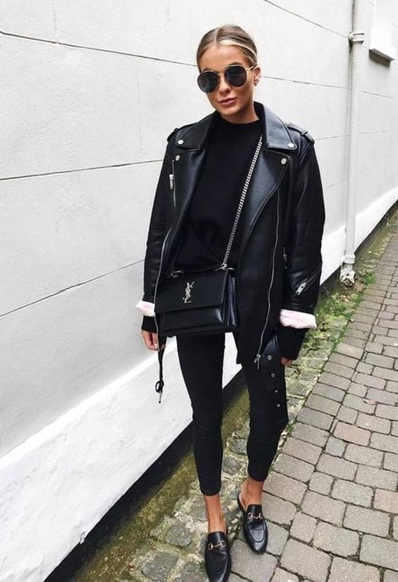 an oversized black leather jacket, a black turtleneck, black cropped skinnies, black mules and a crossbody