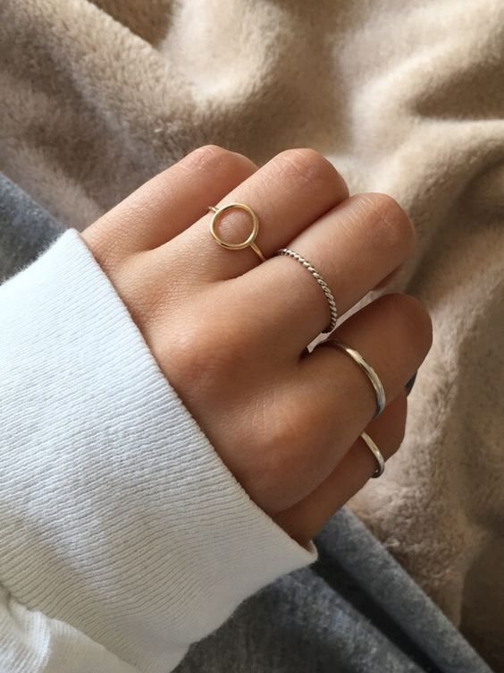 several minimalist rings of silver and gold   matching metals will make you look bolder