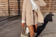 13 a chic tan suit with a mini skirt and an oversized blazer, a white long sleeve top, neutral trainers and a printed bag