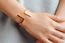 13 a geometric cuff bracelet is a cool statement idea to finish off your outfit