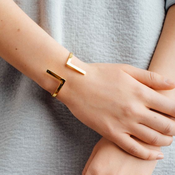 a geometric cuff bracelet is a cool statement idea to finish off your outfit