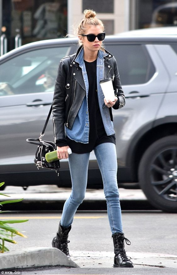 black combat boots, blue skinnies, a black top, a blue denim jacket, a moto jacket and a black bag